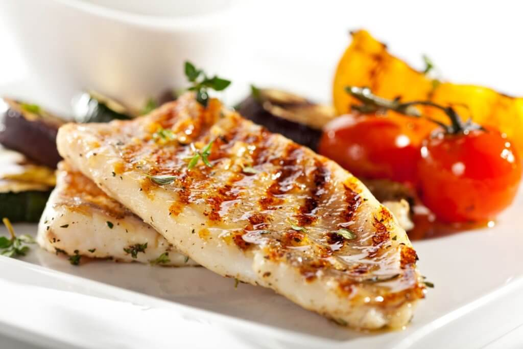 A photo of grilled fish fillet with vegtables