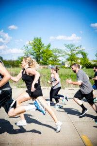 A photo of a training class doing a group run
