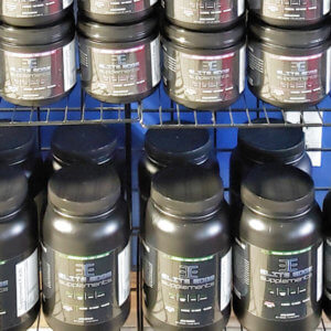 Canisters of Elite Edge supplements line shelves at an Elite Edge Transformation Center location.